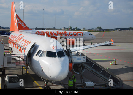 EasyJet Airbus planes at Schiphol Airport Amsterdam Netherlands - Stock Photo