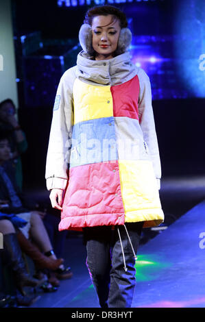 Beijing, China. 19th Jan, 2014. A model presents a creation by American designer Leanne Mai-Ly Hilgart during the - Stock Photo