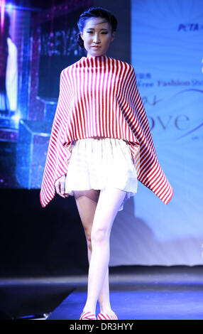Beijing, China. 19th Jan, 2014. A model presents a creation by South Korean designer Gee-eun Lee during the Cruelty - Stock Photo