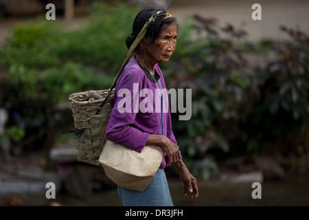 A Hanunoo Mangyan woman walks to a Mangyan market near Mansalay, Oriental Mindoro, Philippines. - Stock Photo