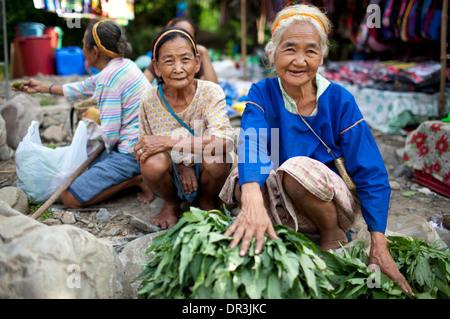 Hanunoo Mangyan women selling their crops at a Mangyan market near Mansalay, Oriental Mindoro, Philippines. - Stock Photo