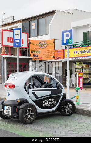 Renault Twizy battery-powered electric car for pizza delivery plugged in to a Sol-lar battery charging point on - Stock Photo
