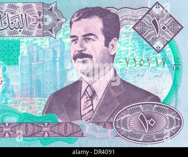 Fragment of the Iraqi banknote with Saddam - Stock Photo