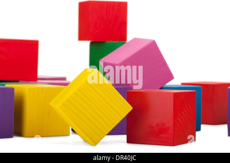 Wooden blocks, stack of colorful cubes, childrens toy isolated on white background - Stock Photo