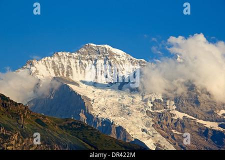 Mount Jungfrau as seen from Wengen village - Stock Photo