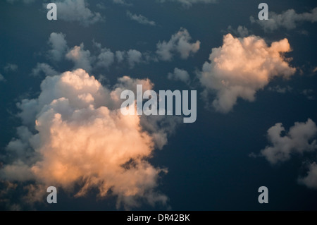 Cumulus clouds over the Pacific Ocean at sunset - Stock Photo