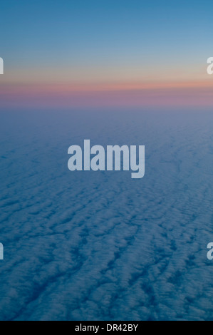 Low level stratus clouds at sunrise over the Pacific Ocean - Stock Photo