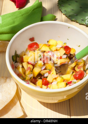 Mango salsa in a bowl - Stock Photo