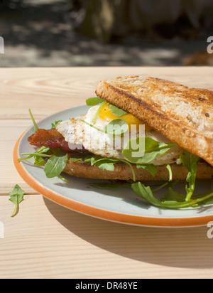 Open faced egg breakfast sandwich - Stock Photo