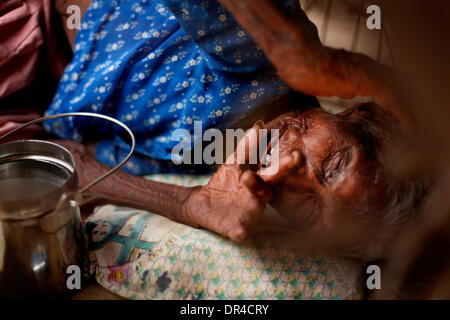 Jan. 12, 2009 - Amhedabad, India - An elderly blind woman suffering from polio lays under a cart on the side of - Stock Photo