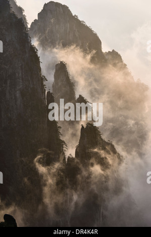 Fog rolling over mountains, Huangshan, Anhui, China, - Stock Photo
