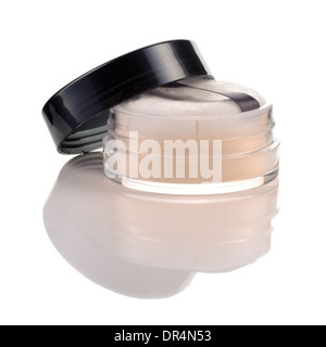 Translucent loose powder in jar with puff isolated on white background. Make-up product with silk. - Stock Photo