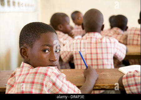 Apr 21, 2009 - Gonaives, Haiti - Students, boys and girls, are back in class at a school rehabilitated by an international - Stock Photo