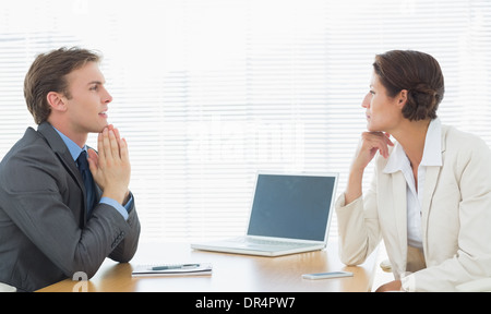 Smartly dressed couple in business meeting at office - Stock Photo