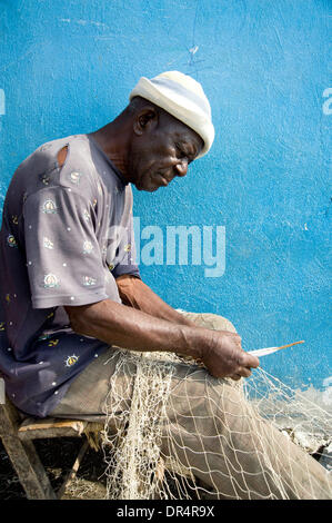 Apr 29, 2009 - Port au Prince, Haiti - Fishermen who received support from an international aid organization mend - Stock Photo