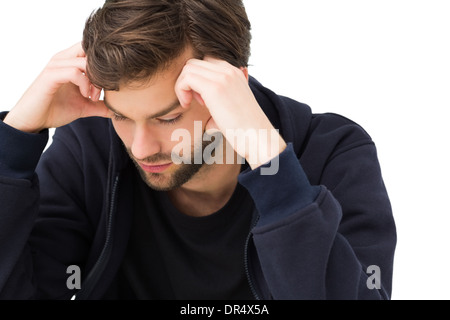 Close-up of a stressed handsome young man - Stock Photo