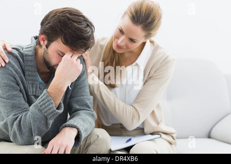 Man in meeting with a financial adviser - Stock Photo