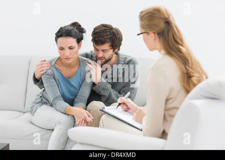 Couple in meeting with a financial adviser - Stock Photo