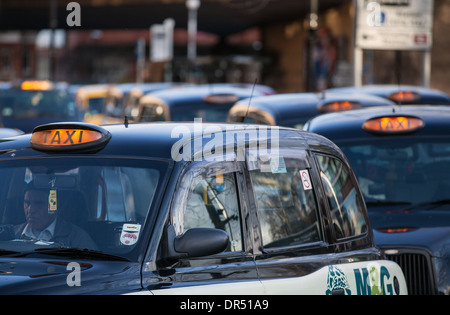 Hackney Cabs, Private Hire Vehicles for hire_ Taxis in Manchester City Centre, Lancashire, UK - Stock Photo