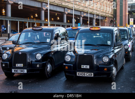 Hackney Cabs, Private Hire Vehicles for hire_ Taxi Fleet in Manchester City Centre, Lancashire, UK - Stock Photo