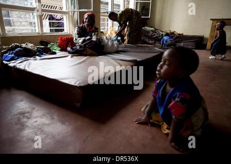 Feb 02, 2009 - Goma, Democratic Republic of Congo - Women and children, waiting in a transit center in Goma represent - Stock Photo