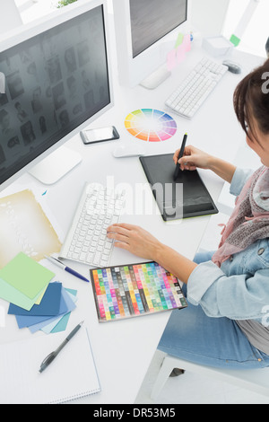Artist drawing something on graphic tablet - Stock Photo