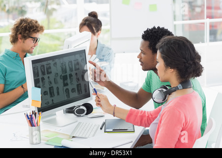 Casual people working on computers in office - Stock Photo