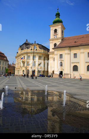 Piata Mare, Big Market Square, town hall and church, Sibiu (Hermannstadt), Transylvania, Romania, Europe - Stock Photo