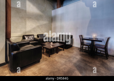 Tables and chairs in empty restaurant - Stock Photo