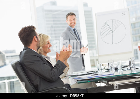 Business people in office at presentation - Stock Photo