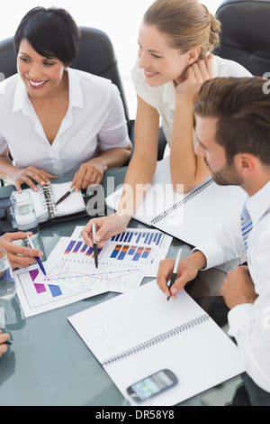 Young well dressed business people in meeting - Stock Photo