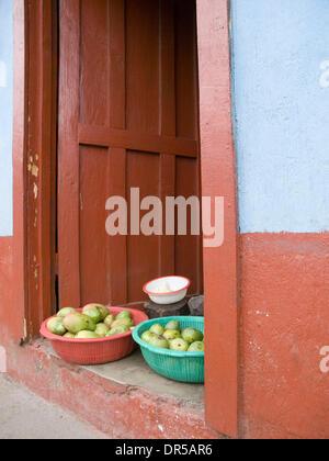 Mar 29, 2009 - Santiago Atitlan, Solola, Guatemala - Veggies for sale in doorway in Santiago Atitlan, Solola, Guatemala - Stock Photo