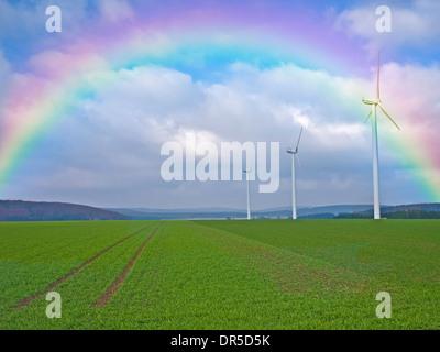 wind wheels with rainbow - Stock Photo