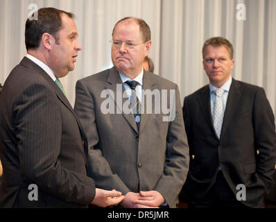 Jan 19, 2009 - Brussels, Belgium - New Austrian Fiance minister JOSEF PROELL (L), German Finance Minister PEER STEINBRUECK - Stock Photo