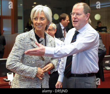 Jan 20, 2009 - Brussels, Belgium - German Finance Minister PEER STEINBRUECK chats with French Minister for Economy - Stock Photo