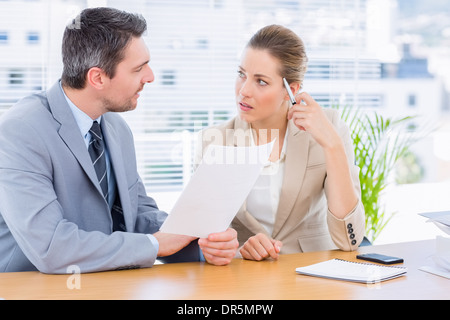 Smartly dressed colleagues in business meeting - Stock Photo