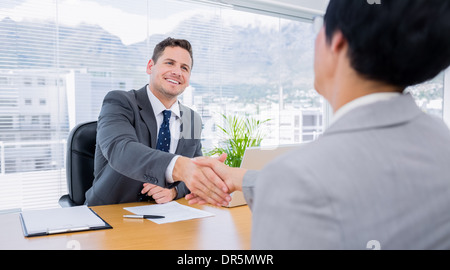 Executives shaking hands after a business meeting - Stock Photo