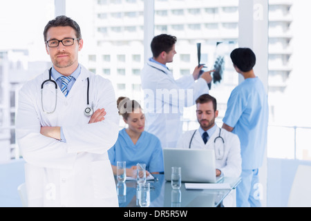 Doctors at work in medical office - Stock Photo