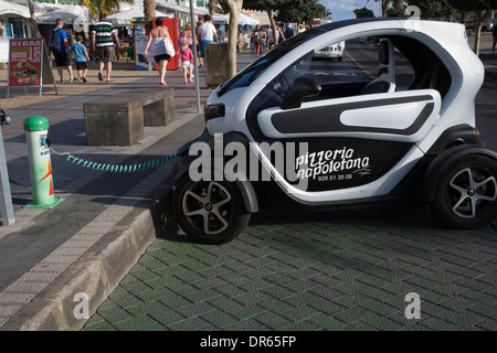 Lanzarote Canary Islands Renault Twizy electric car on charge at road side - Stock Photo