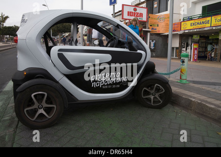 Lanzarote Canary Islands Renault Twizy electric car on charge at road side cheap to run Pizza delivery car - Stock Photo