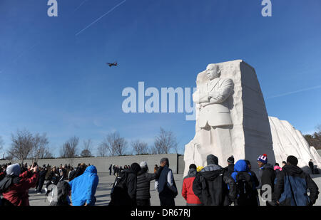 Washington DC, USA. 20th Jan, 2014. People gather around the statue of Martin Luther King Jr. in Washington DC, the United States, Jan. 20, 2014. Various activities are held on the third Monday of January each year throughout the United States to honor Martin Luther King Jr., who was assassinated on April 4, 1968 at the age of 39. Credit:  Yin Bogu/Xinhua/Alamy Live News
