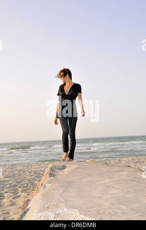 Young woman at the beach, Niendorf, Germany - Stock Photo