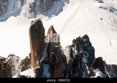Needle rocks near the summit of the Aiguille du Midi (3842m) in the Mont Blanc massif in the French Alps - Stock Photo