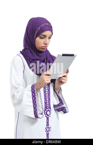 Arab woman bored reading a tablet reader isolated on a white background - Stock Photo