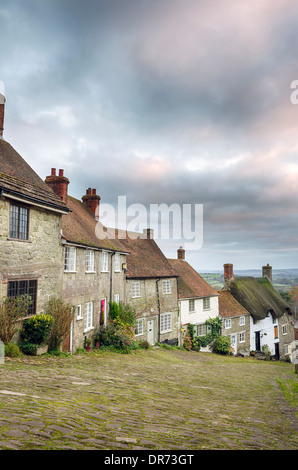 A row of quaint English cottages at Gold Hill in Shaftesbury, Dorset - Stock Photo