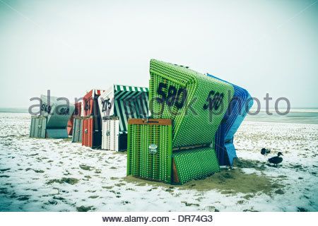 Germany, Lower Saxony, beach chairs at the beach of Langeoog - Stock Photo
