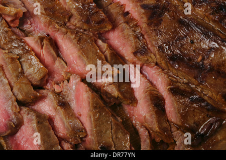 Thinly sliced marinaded and grilled flank beef steak, or London broil as it is known in the US - Stock Photo