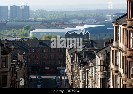 View to the Riverside Museum, Glasgow. Museum of Travel and Transport with older housing in the foreground - Stock Photo