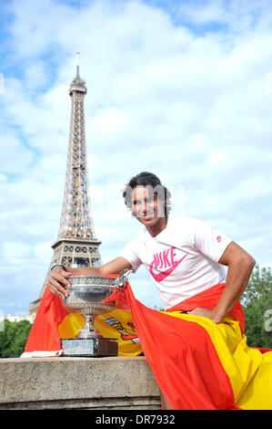 Spanish tennis player Rafael Nadal with his trophy in front of the Eiffel tower after winning the Men's Singles final tennis match of the French Open tennis tournament at the Roland Garros stadium. Paris, France - 11.06.12