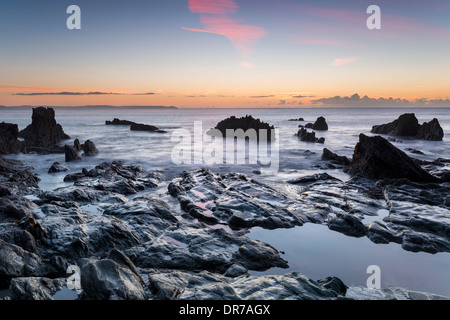 Sunrise at the beach at Looe on the south coast of Cornwall - Stock Photo